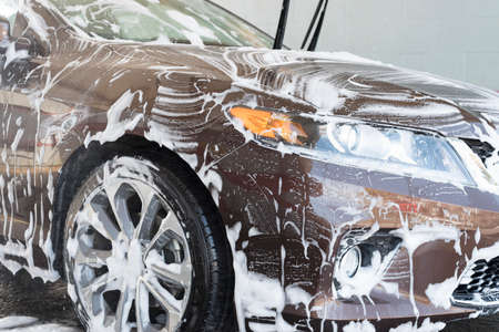 car wash with lot of soap and foam Imagens
