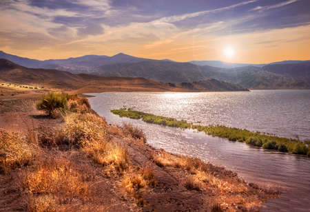 mountain landscape with lake and sunset Imagens - 63806181