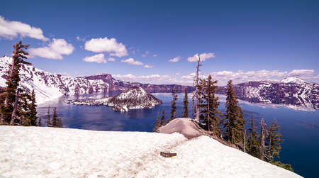 Crater Lake, with snow top mountain and clear blue lake