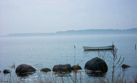 Foggy boat Stock Photo