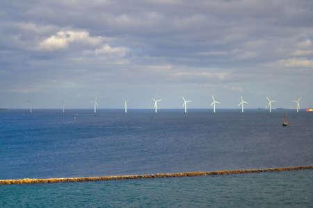 Ocean windmill in distance