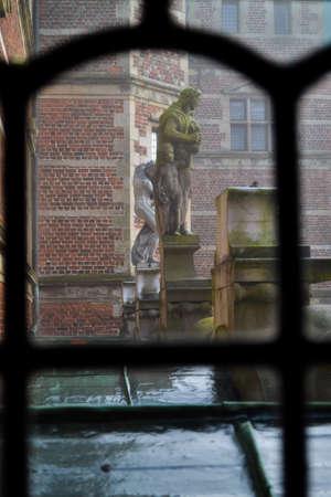 Statue behind bars