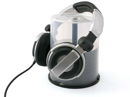 Headphones on bulk of CD disks on white background
