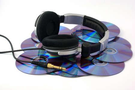 Headphones on CD disks on white background
