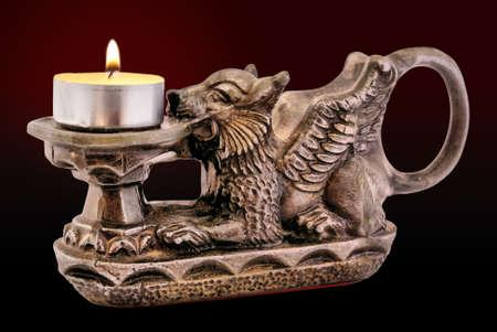 lion figurines: Candleholder Stock Photo