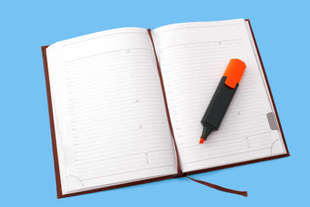 Opened notebook with orange text marker isolated on white background