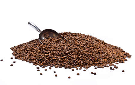 Metal scoop partially burried in coffee beans heap isolated on white background Stock Photo
