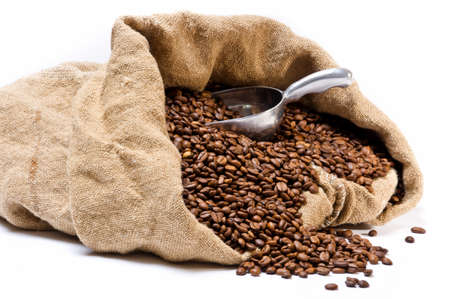 Coffee beans sack with scattered beans and metal scoop isolated on white background Stock Photo - 8985368