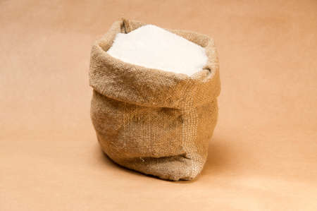Sack with sugar on extra-strong paper background Stock Photo