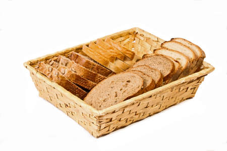 Basket with different kind sliced bread isolated on white background photo