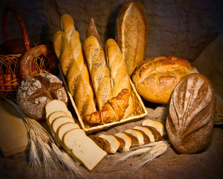 Still life with bread on light background Stock Photo