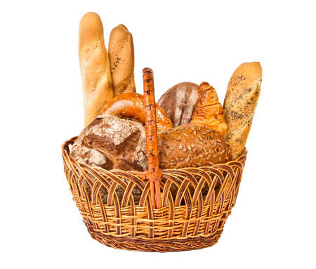 Woven basket with different kind of bread isolated on white background