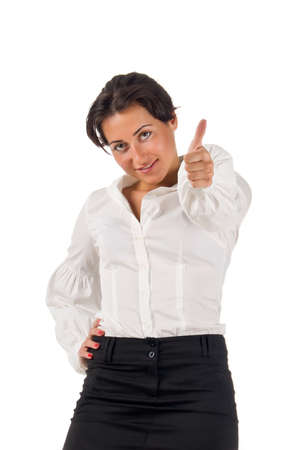 Dark haired white blouse and black skirt dressed  young business woman smiles and set thumb up on white background Stock Photo - 10466534