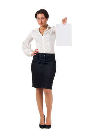 Dark haired white blouse and black skirt dressed  young business woman show blank paper page isolated on white background Stock Photo