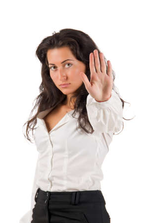 dark haired: Dark haired white blouse and black skirt dressed  young business woman show stop sign by her own hand on white background. On the hand focus