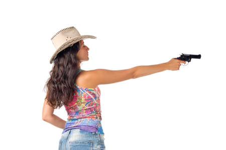 Young dark haired woman wear a hat aim a gun isolated on white background photo
