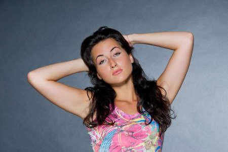 dark haired woman: Young beautiful dark haired woman studio shot