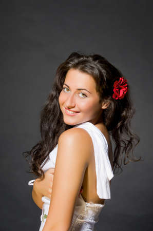 spanish style: Portrait of young dark haired beautiful woman. Gypsy, spanish style