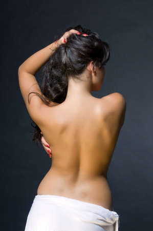 Young dark haired beautiful woman topless. Back view Stock Photo