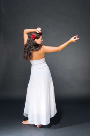 Dancing young dark haired beautiful woman. Gypsy, spanish style photo