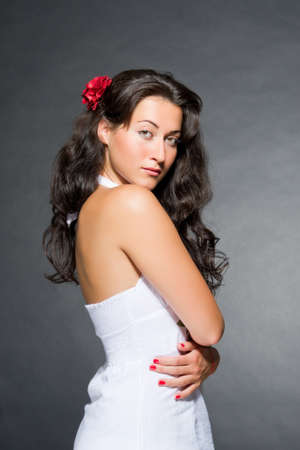 Young dark haired beautiful woman white sundress wear. Spanish, gypsy  style photo