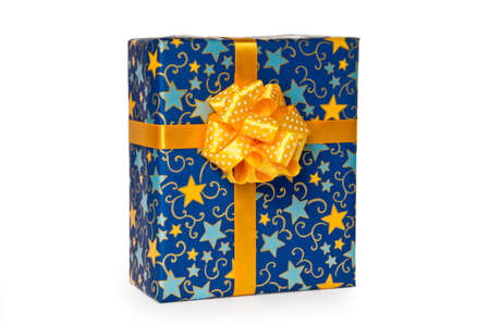 Blue gift box with yellow bow and ribbon isolated on white background Stock Photo - 11723868