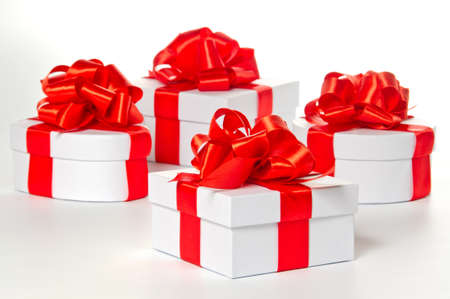 pasteboard: Four white pasteboard gift boxes with red satin ribbon Stock Photo