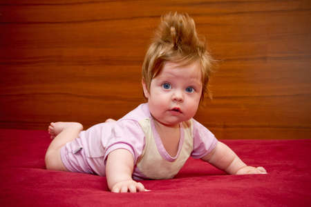 Cute funny touching baby girl with cheerful coiffure  Stock Photo - 16305867