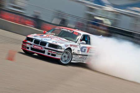 Odessa, Ukraine - July, 7-8, 2012. King of Europe, IV stage. Black Sea Drift Challenge. Drift sport car in sharp sideslip. A lot of smoke. Stock Photo - 16286943