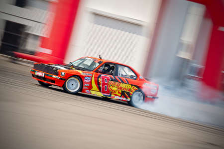 Odessa, Ukraine - July, 7-8, 2012. King of Europe, IV stage. Black Sea Drift Challenge. Drift sport car in sharp sideslip. A lot of smoke. Stock Photo - 16286927