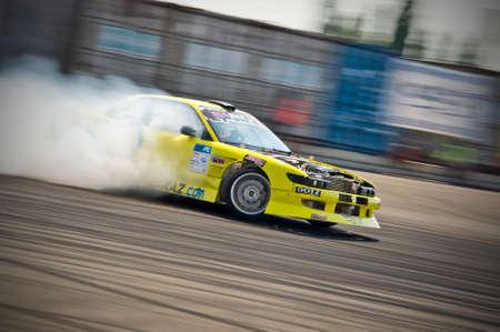 Odessa, Ukraine - July, 7-8, 2012. King of Europe, IV stage. Black Sea Drift Challenge. Drift sport car in sharp sideslip. A lot of smoke.