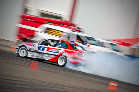 Odessa, Ukraine - July, 7-8, 2012. King of Europe, IV stage. Black Sea Drift Challenge. Drift sport car in sharp sideslip. A lot of smoke. Stock Photo - 16286934