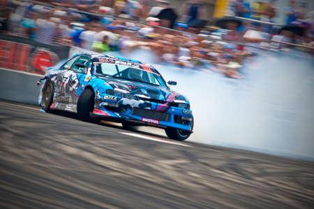 Odessa, Ukraine - July, 7-8, 2012. King of Europe, IV stage. Black Sea Drift Challenge. Drift sport car in sharp sideslip. A lot of smoke. Stock Photo - 16286926