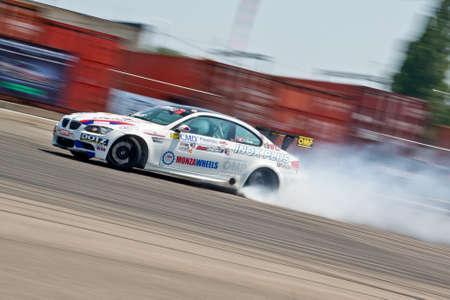 Odessa, Ukraine - July, 7-8, 2012. King of Europe, IV stage. Black Sea Drift Challenge. Drift sport car in sharp sideslip. A lot of smoke. Stock Photo - 16286924