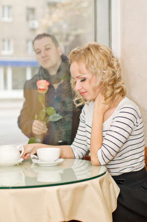 Attractive young woman waits a boyfriend at small cafe Stock Photo - 16932706