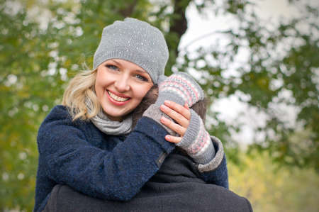 Date  Happy young woman hugs a man outdoor Stock Photo