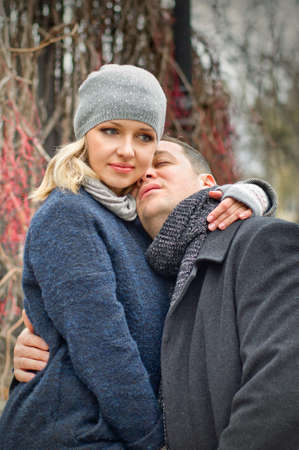 Date  Young blonde woman hugs a man outdoor  Autumn photo