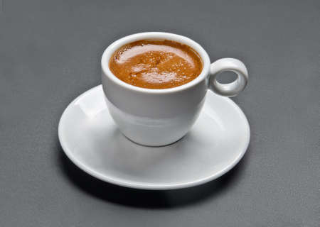 White ceramic cup of espresso coffee on grey background  Isolated with clipping path  Stock Photo