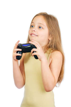 Young scared cute girl with grey blue eyes and long light brown hair plays computer game with joystick isolated on white background