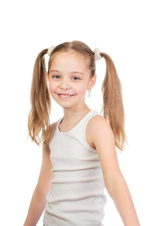 Young cute smiling girl with grey blue eyes and two hair tails isolated on white background