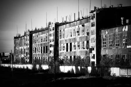 ruinous: Old ruinous factory perspective view. Black and white horror concept. Stock Photo