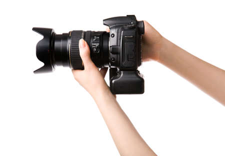 megapixel: Woman hands holding professional photo camera. Isolated on white. Stock Photo