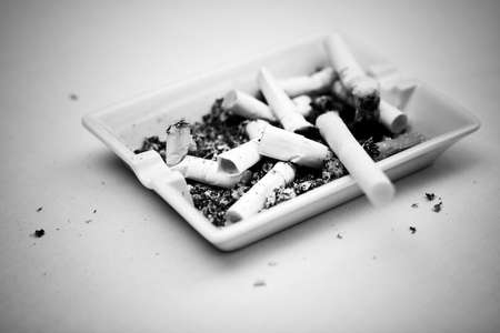 bw: Ash-tray with cigarettes. Concept bw image.