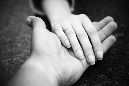 touching hands: Helping hand. Black and white concept.