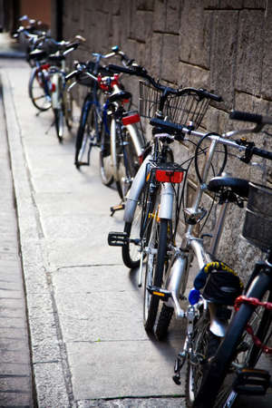 Bicycles near the wall. Traditional Italy small side-street. photo