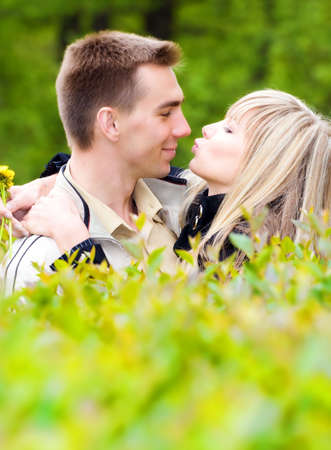 Young couple kissing in green bushes. Stock Photo - 5061203