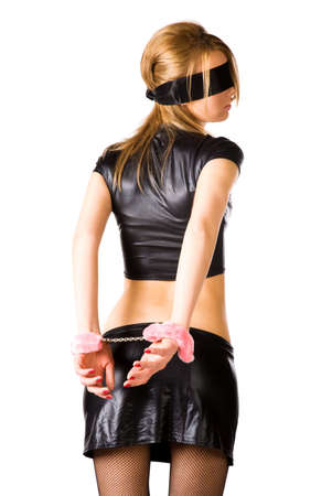 Young woman with pink handcuffs. Isolated on white. Stock Photo - 5061196