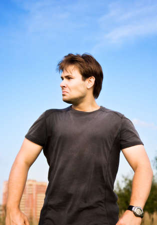 Very angry man walking. On blue sky background.