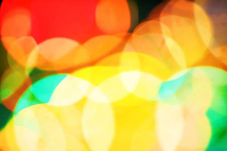 saturated: Abstract unfocused lights background. Saturated colors.