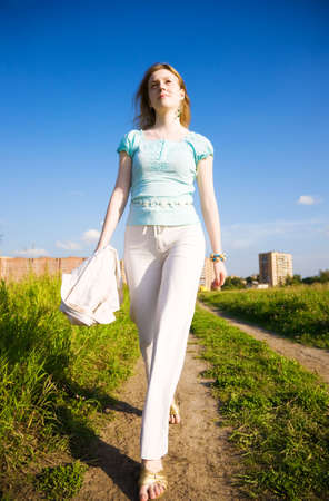 Young independent woman walking. Wide angle view. Stock Photo - 5061222